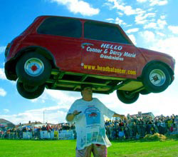 john evans headbalancing his most famous object a mini cooper car