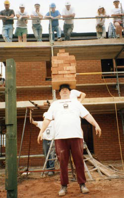 john evans in the old days, working on the building sites, carrying bricks by balancing on his head...